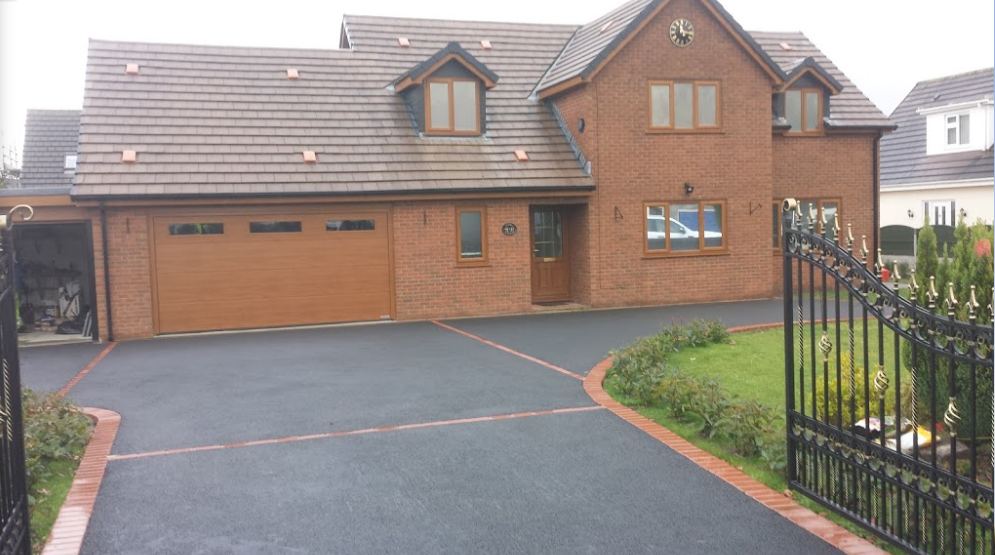 Completed Tarmac Driveway with decorative brick paving by our Tarmac Driveways Swansea team on proprty in Ystradgynlais